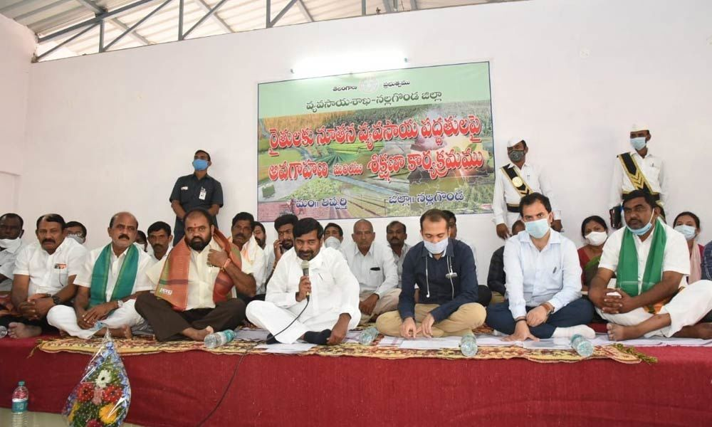 Minister Jagadish Reddy addressing the farmers on new farming techniques at a training programme held at Thipparthi on Thursday